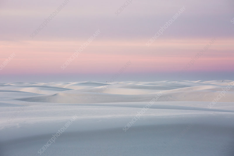 Sunset over tranquil white sand dune