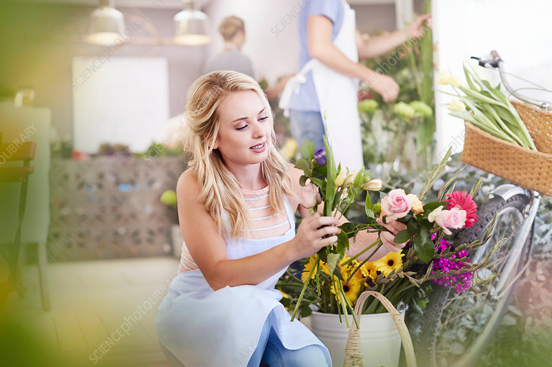 Florist selecting flowers in flower shop