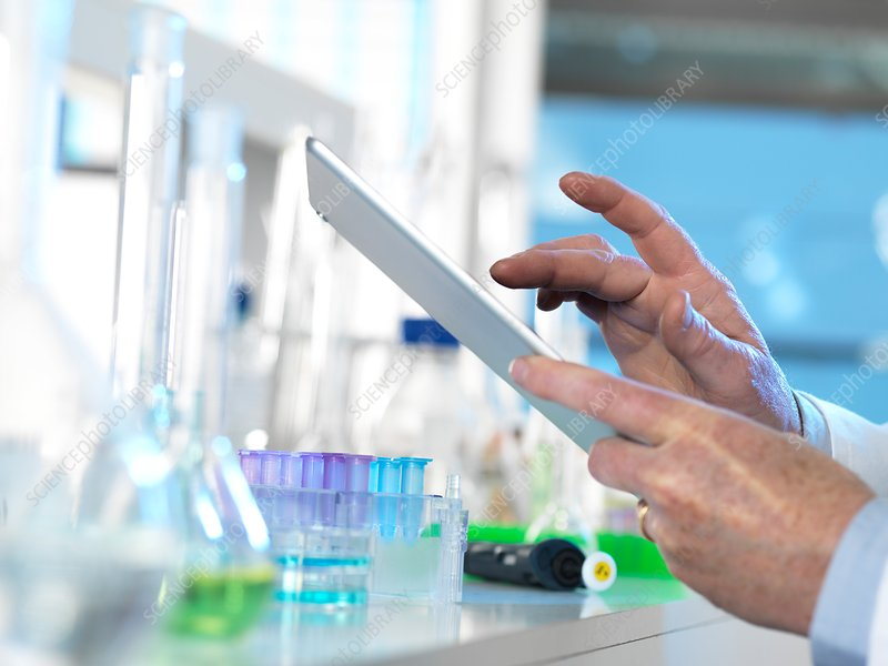Scientist using a digital tablet