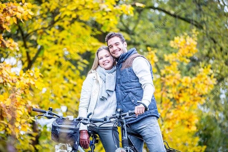 Couple cycling together