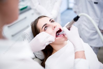 Dentist drilling patient's tooth