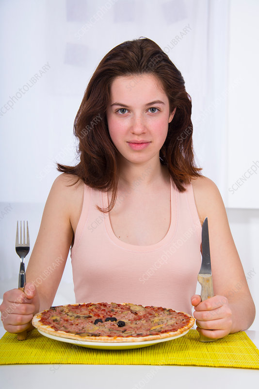 Teenage girl with a plate of pizza
