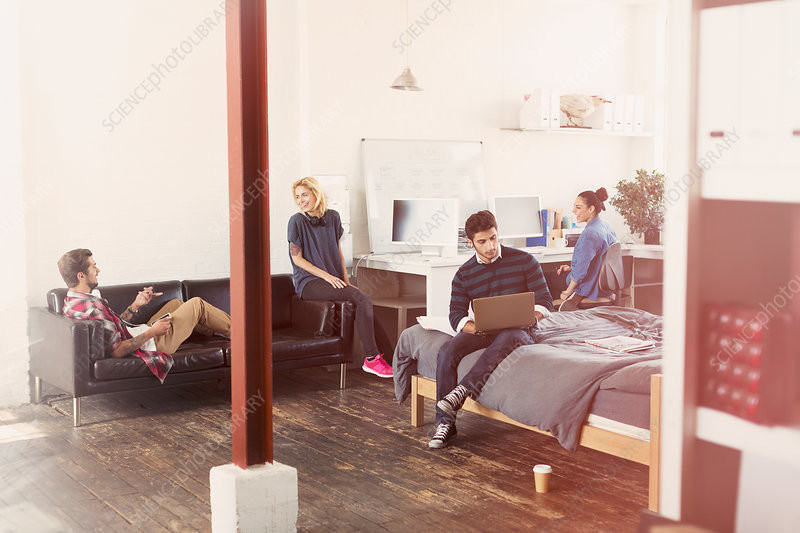 Friends hanging out in loft apartment