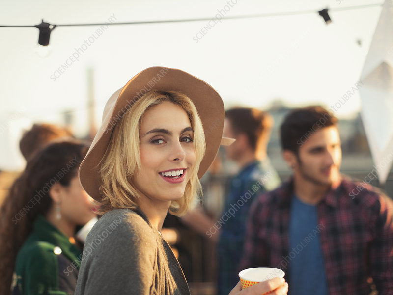 Woman enjoying rooftop party