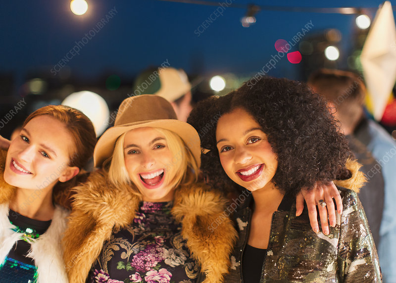 Women enjoying rooftop party
