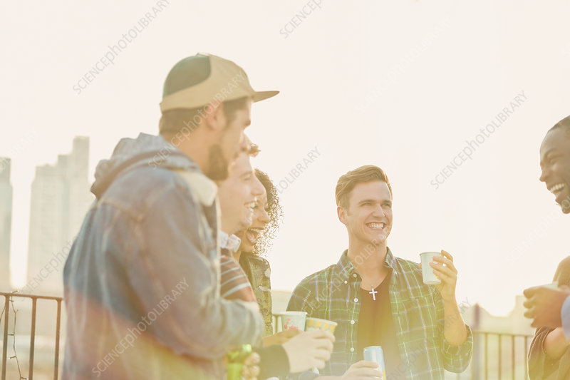 Young adult friends drinking and talking