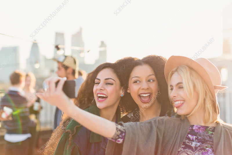 Enthusiastic young women taking selfie