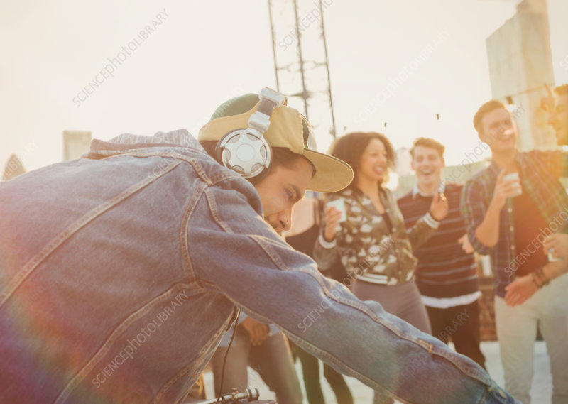 DJ with headphones at rooftop party