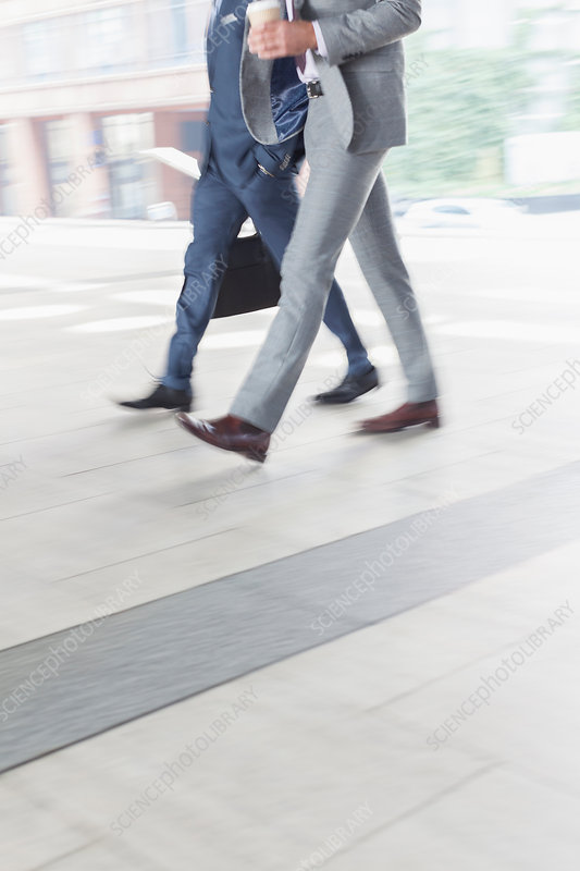 Corporate businessmen walking with coffee