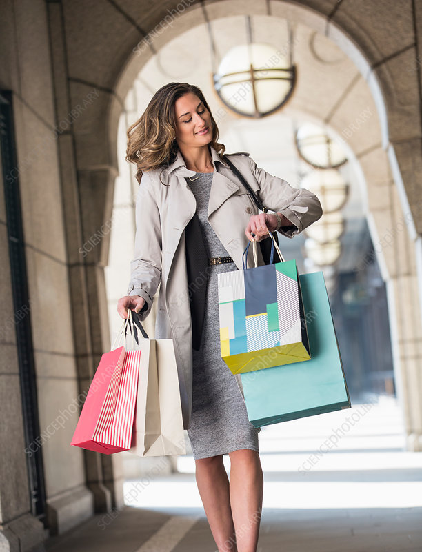 Businesswoman with shopping bags