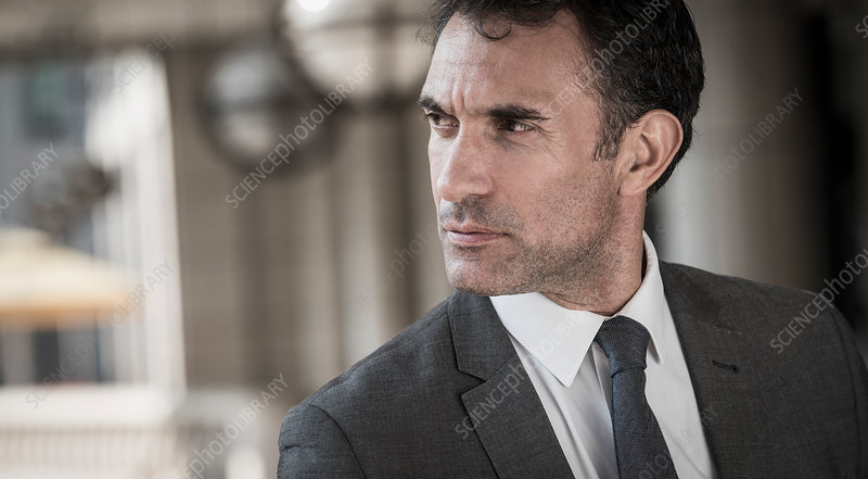 Close up pensive Businessman looking away