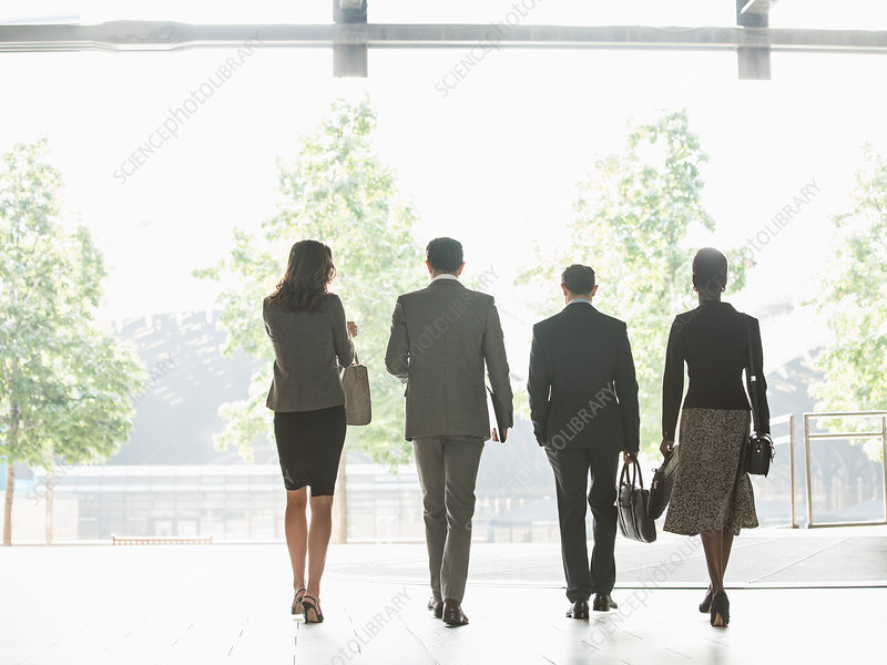 Business people walking in a row