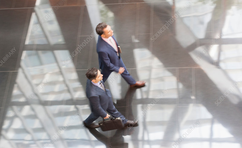 Corporate businessmen walking lobby