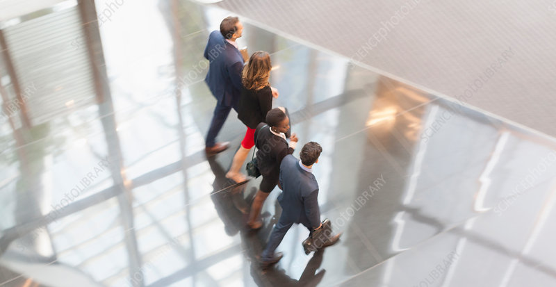 Business people walking in a row lobby