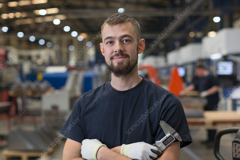 Portrait confident worker in factory