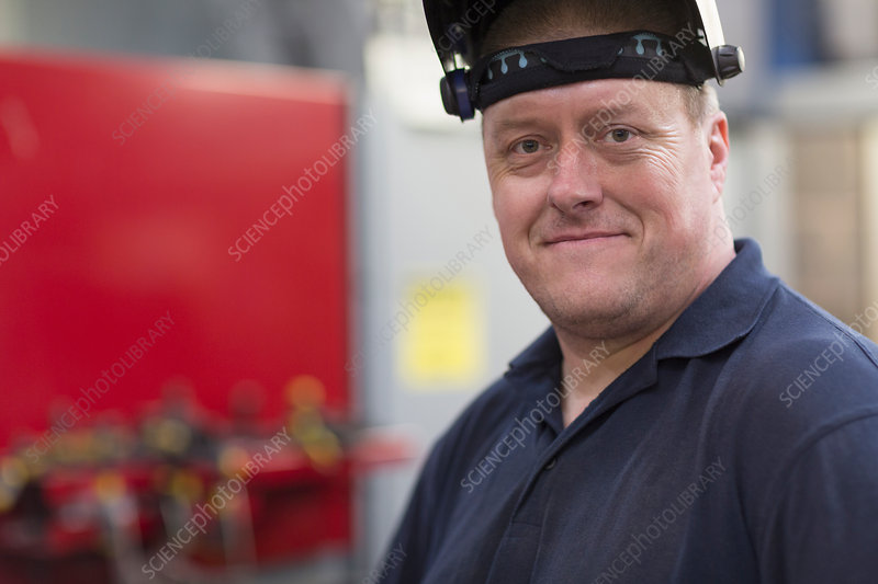 Portrait confident welder in factory