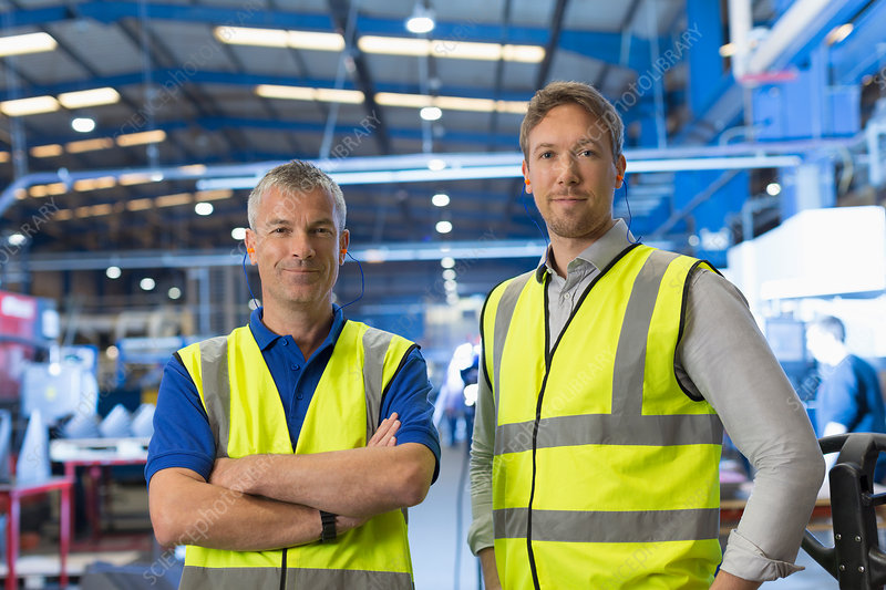 Portrait confident supervisors in factory
