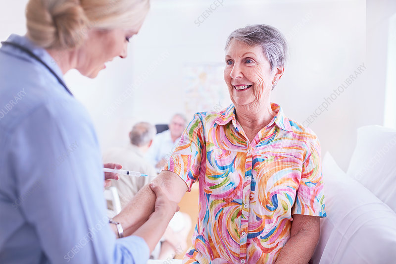 Doctor checking senior woman