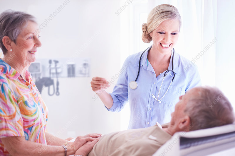 Smiling doctor checking senior man