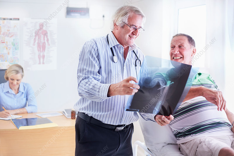 Doctor showing senior man x-ray