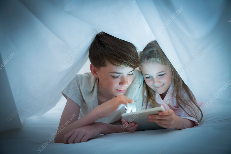 Brother and sister sharing tablet