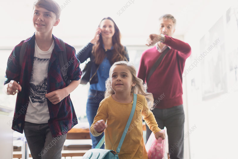 Family rushing to leave house