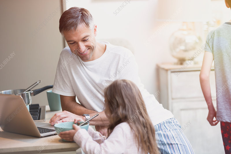 Father and daughter enjoying breakfast