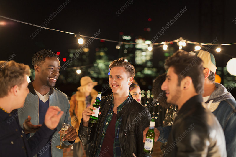Young men drinking beer and talking