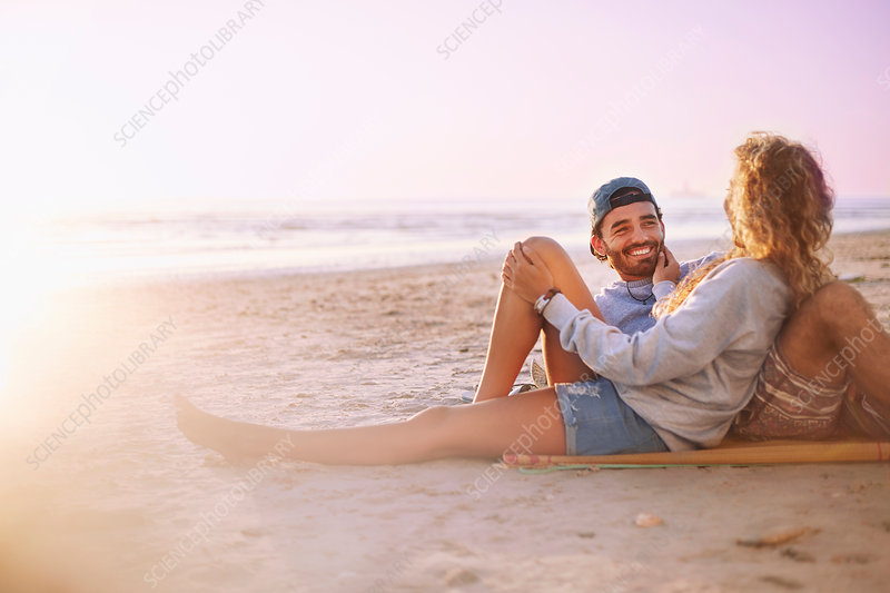 Smiling couple relaxing and talking