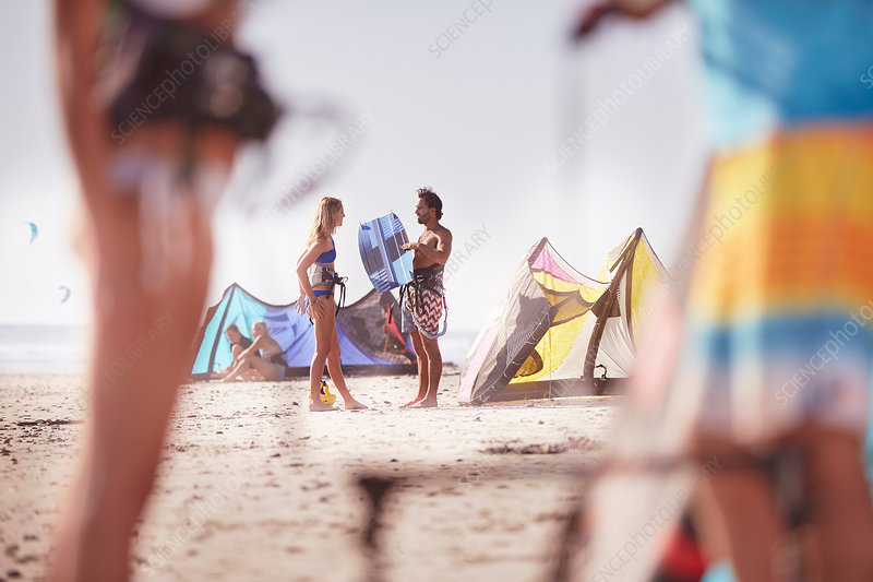 People with kiteboarding equipment