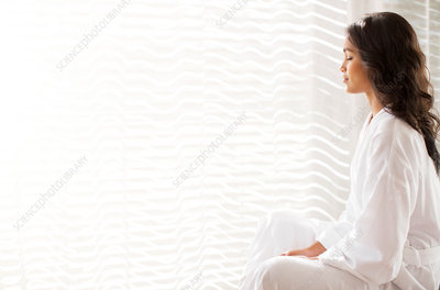 Serene woman in bathrobe