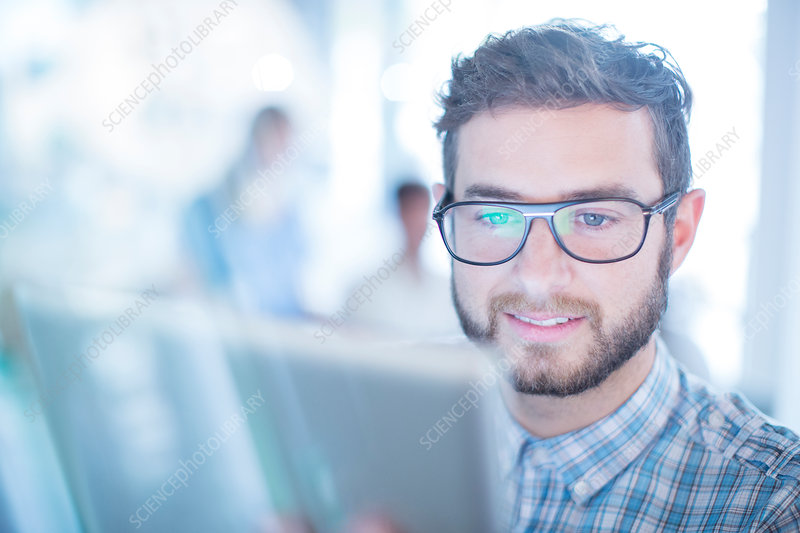 Businessman with eyeglasses using tablet