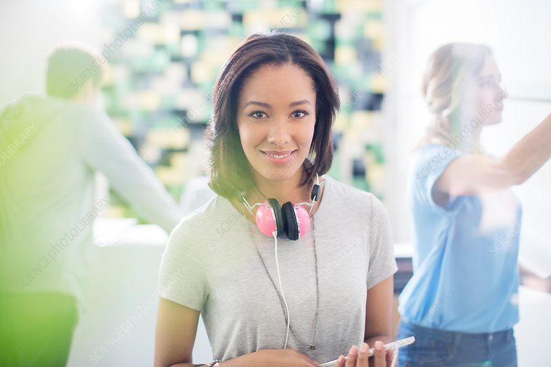 Businesswoman with headphones in office