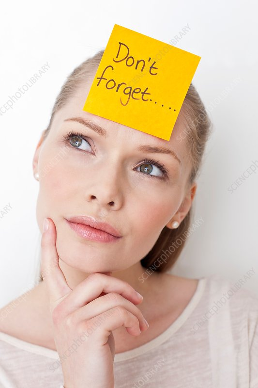 Young woman with sticky note