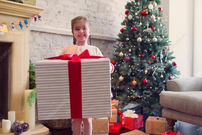 Girl holding large Christmas gift