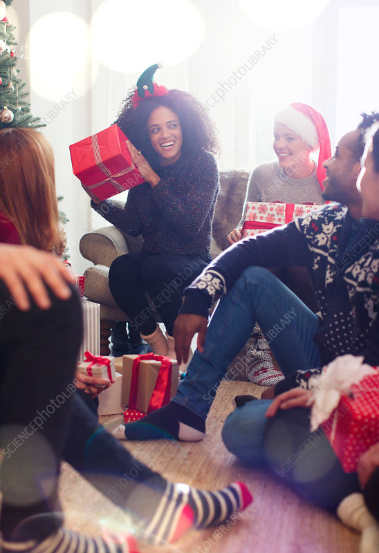 Friends opening Christmas gifts