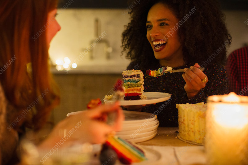 Laughing friends at candlelight table
