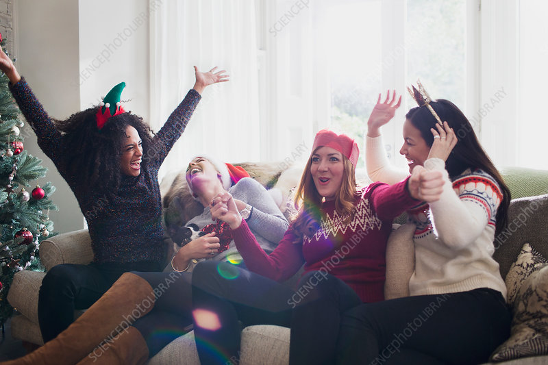 Laughing friends celebrating Christmas