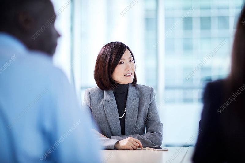 Businesswoman listening in meeting