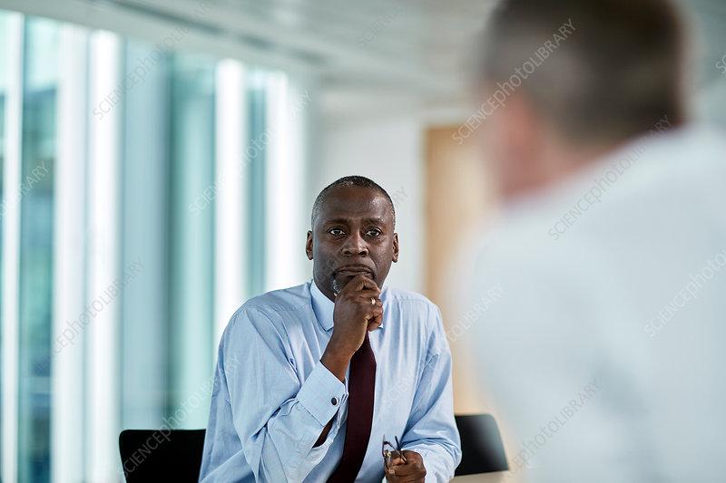 Businessman listening to colleague