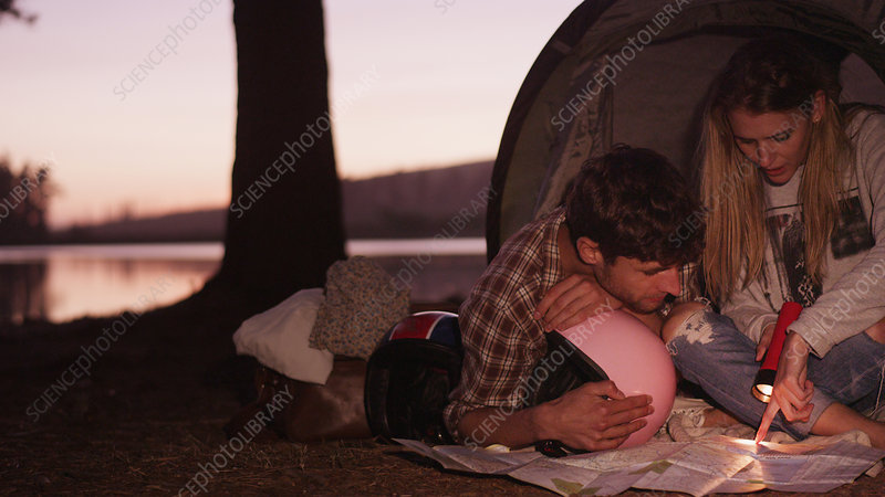 Young couple in camping tent