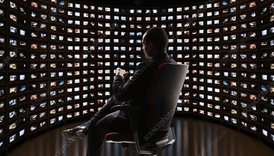 Man watching video on monitors