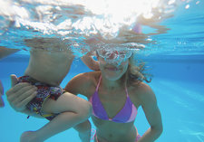Mother and son swimming underwater