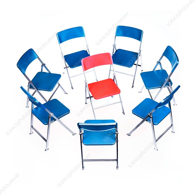 Circle of chairs with one in the middle