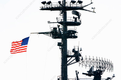 Radar and aerial masts with a US flag
