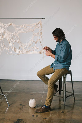 An artist working on an art piece