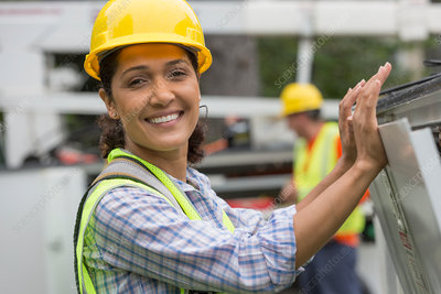 Hispanic female utility worker