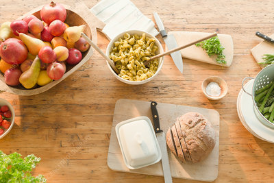Pasta, fruit and bread on dining table