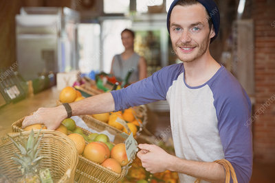 Man shopping for oranges in market