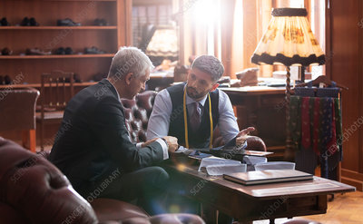 Tailor and businessman talking